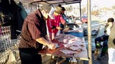 Vina del Mar, Chile - 2019-07-27 - Three Fishermen Work To Turn 100s of Reine Fish Into Filets.