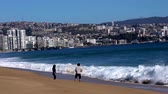 Vina del Mar, Chile - 2019-07-28 - Young Couple Retreat From the Surf.