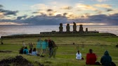 People Start to Leave After Sunset in Front of Moai on Easter Island.