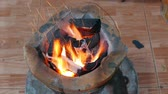cooking : Burning charcoal in stove for preparing  traditional food of Thailand. It is popular for all homes in cooking with a stove that provides high thermal energy and economical.
