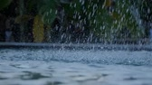 spurt : Closeup of splashes of beautiful garden fountain in slow motion