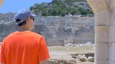 説明 : Man tourist walking in ancient greek agora in Patara, Turkey