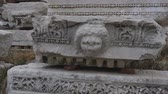 ephesus : Part of marble frieze detail, Sagalassos, Turkey. Ancient Greek ornamets and lions face Stock Footage