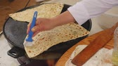 paste : Womans hand oils gozleme, traditional Turkish food, on a special pan Stock Footage