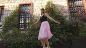 koketa : Fashion lifestyle portrait of young happy pretty woman in pink tulle skirt jumping funnily on street background Dostupné videozáznamy