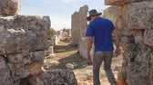 panama city : Young man archaeologist in panama hat exploring ancient city Lyrboton in Turkey Stock Footage