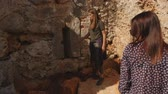 sugerir : Two young girls walking in ancient city Lyrboton Kome in Turkey