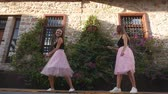 hélio : Fashion lifestyle two young happy pretty women in pink tulle skirt funnily meet each other