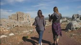 antalya : Two young girls walking in the ancient city Lyrboton Kome in Turkey