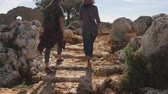 antalya : Two young girls walking on ancient stairs in ancient city Lyrboton Kome in Turkey Stock Footage