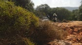 tribu : Group of hikers with backpack walking along the road strewn with small stones Vidéos Libres De Droits