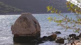 гробницы : Ancient greek stone tomb on the sea shore washed by water in Kekova. It was looted many years ago