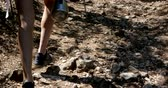 wanderstiefel : Close up of women legs hiking forest path with vaccum flask