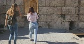 open air museum : Young women tourist walking with map in Ancient city Perge with antique colonnada ruins of ancient temple roman architecture on background. This is open air antique historical museum in Turkey Stock Footage