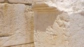 выгравированы : Ancient Greek writing chiseled on white stone. Patara Turkey