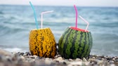 미각 : Sweet summer days fresh melon and watermelon bowl cocktail on the marble beach with sea waves on background. Summer holiday concept