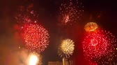 Colorful holiday fireworks in the night sky with city in background Stok Video