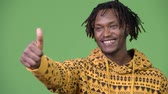 rasta : Young handsome African man giving thumbs up Stock Footage