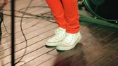 discotheque : The legs of a musician closeup Bouncing to the music at the concert. Stock Footage