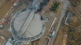 fire truck : Krasnoyarsk, Russia - 08 may, 2018: Aerial view of the extinguishing a major fire on the roof of the stadium. Stock Footage