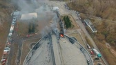 above fire : Krasnoyarsk, Russia - 08 may, 2018: Aerial view of the extinguishing a major fire on the roof of the stadium. Stock Footage