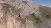 спасение : Aerial shot of group of climbers working with a rope. Rescue work climbing to the top of the mountain.