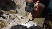 perforator : Close-up of the hammer drill a hole in the rock. Stock Footage