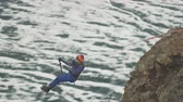 Climber crossing the gorge on a rope. Wideo