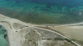 enrolamento : Long shot of cars driving slow at beach road near turquoise calm sea waters in Lemnos, Greece