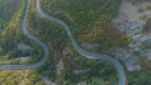 kovalamak : Top view from drone following white truck and car driving along mountain winding road in sunny summer day