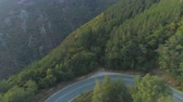 kovalamak : An Aerial View Of A Mountain Pass Asphalt Road with Beautiful Forest Landscpae