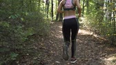 antreman : Energetic Female Jogger Exercising In the Morning, Running Along Forest Path