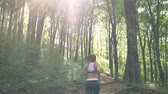 antreman : Morning Sun Rays Shine On Fit Female Jogger, Running In the Forest