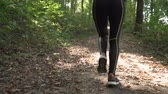 antreman : Fit Athletic Girl Jogging In Slow Motion In the Park In Hot Summer Day
