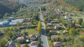 oogschaduw : Aerial view of landscape village countryside and green field. Car driving along straight road trough the houses