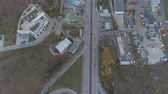 eyaletler arası : Top view of city entrance, cars driving on bypass road. Full parking lot at the side