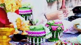 symbol of respect : Footage Thai woman making a tradition Thai flowers garland activities in Songkran festival, Bangkok Thailand.