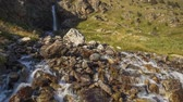 park : Russia, time lapse. Movement of clouds and water flows in a stormy river in the Caucasus mountains in summer Stock Footage