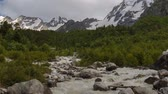 elbrus : Movement of clouds and water flows in a stormy river in the Caucasus mountains in summer