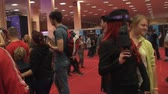 gamers : Bucharest, May The 10th East European Comic Con, Hand Held Cosplayers Posing And People Taking Pictures