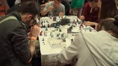 gamers : Bucharest, May The 10th East European Comic Con, People Painting Board Games Figurines Tilt Shot Stock Footage