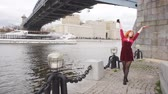 mesire : Dancing red-haired girl on the waterfront Stok Video