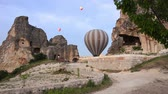 zeplin : Hot air ballon tour, voyage, trip, journey, adventure at Cappadocia, Urgup, Turkey. Colorful hot air balloons flight on sky. The area is a popular tourist destination, as it has many areas with unique geological, historic, and cultural features.  The regi