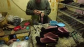 lehúzó : Shoe maker, master, craftsman, workman is manufacture, produce, make  oxford style man shoes in a small atelier.