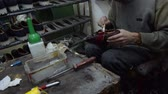 szewc : Shoe maker, master, craftsman, workman is manufacture, produce, make  oxford style man shoes in a small atelier.