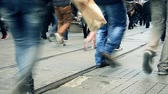 jednotnost : Commuters public are walking on a very crowded pedestrianized zone legs and foots