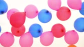 windy : Colorful balloons for target practice floating on a string near sea on a wind day. Stock Footage