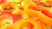 bell pepper ring : Slices of red and yellow bell pepper, close up dolly shot Stock Footage