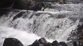 drench : Slow motion video of rapids and rocks