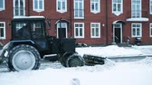 classic : Tractor shoveling away snow in residential area